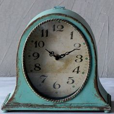 Antiquely designed, the Oval Metal Mantle Clock will blend in perfectly with your room decor. Distressed aqua frame, along aqua accents on the clock face, are highlighted by large black numbers and hands on an off-white face. Tabletop Clocks, Mantel Clocks, Old Clocks, Vintage Clocks, Clock Table, Vintage Props, Clock Decor, Vintage Typewriters, Antique Clocks