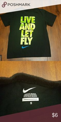 Boy's Nike Shirt  Black Nike shirt with bright green camo on lettering. Blue Nike symbol. Good condition. Lots of wear left in it! Nike Shirts & Tops Tees - Short Sleeve