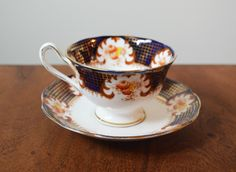 Royal Albert Blue and Gold Cloisonné Bone China teacup, made in England. Hand stamped 8215 by Trashtiques on Etsy https://www.etsy.com/ca/listing/226258343/royal-albert-blue-and-gold-cloisonne