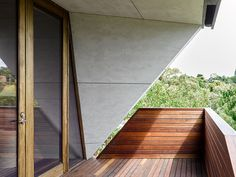 Detail of the chamfered master suite balcony wall featuring compressed cellulose reinforced sheet and sotted gum timber decking | Chamfer House by Mihaly Slocombe (2015) | Frankston South, Victoria, Australia | photo: Andrew Latreille