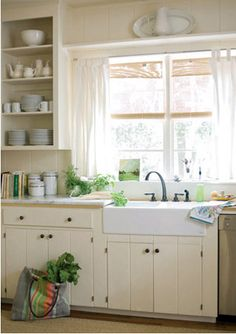 white kitchen with tons of lights