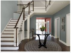 Wall color on right is Cloudy Sky and stairway wall is Smoke (Benjamin Moore) Source: Benjamin Moore