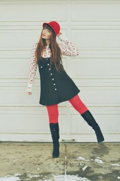 Red opaque tights, black lace up boots, vintage dress and white sweater with red flower print