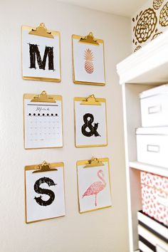 really love this idea of hanging gold clipboards on the wall! Lets you easily switch out calendars or cute prints!
