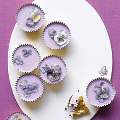 Spring Cupcakes with Sugared Flowers: These dainty confections, topped with fresh lavender-infused icing, are actually made from dark, indulgent brownie batter. Sugared pansies and violas form a glittering crown for the little cakes, which are rich enough to replace the pot of gold at the end of the rainbow.