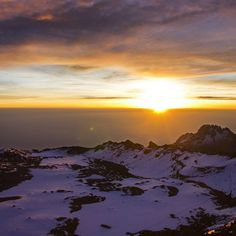 One of the most beautiful sunrises I've ever seen - from the summit of Mount Kilimanjaro.  Even more beautiful was the experience of seeing this sunrise after the hard work and challenge of reaching the summit during the dark and cold night.