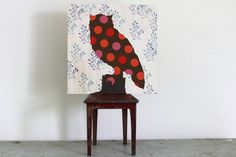 Put fabric on a canvas and then paint on top of it! Easy DIY