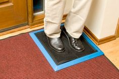sanitizing shoe and boot mat disinfects shoe soles and treads when stamped on.