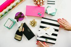 wrapping Kate Spade gifts http://www.itgirlweddings.com/blog/10-perfect-gift-ideas-for-your-bridesmaids