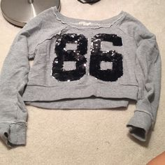 Cropped sweatshirt Well made from forever 21. Cropped and can be worn off the shoulder. So cute for football season. Only worn once. No sign of wear. Forever 21 Tops Sweatshirts & Hoodies
