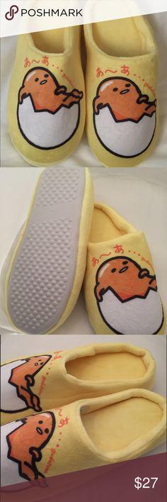 Sanrio Gudetama Plush Slippers Sanrio's Popular Japanese Character Gudetama Slippers sizes Medium or Large available. Brand New never worn. Size Shoe Medium 5-6 Large 7-8 Sanrio Shoes Slippers