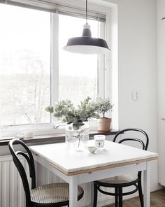 Dining table near the window, Thonet chairs