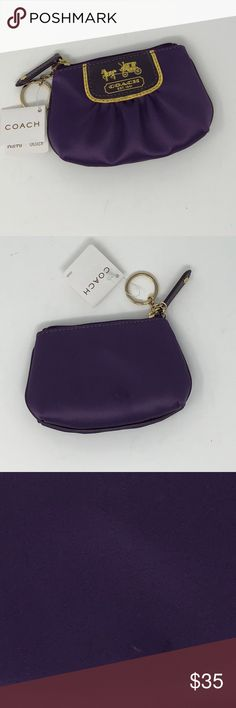 Coach Amanda Satin Plum Mini Skinny Coin Purse NWT NWT Coach coin purse with key ring. Amanda Satin in Plum. There is a small mark on the back. Please see picture. Coach Bags Wallets