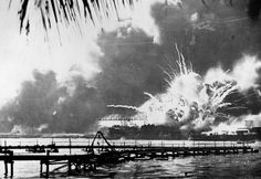 The USS Shaw explodes after being hit by bombs during the Japanese surprise attack on Pearl Harbor, Hawaii.