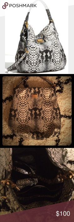 Marc Jacobs Supersonic Snake Printed Hobo Handbag This slightly pre-loved AUTHENTIC Marc by Marc Jacobs faux python hobo shoulder bag hold sentimental value, as is was my first designer handbag purchase! Would love to pass it on to someone who will appreciate its beauty! Marc by Marc Jacobs Bags Hobos