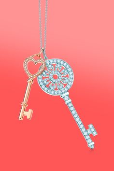 Two keys to happiness. Tiffany Keys heart key charm in 18k rose gold with diamonds and petals key pendant in platinum with diamonds. #TiffanyPinterest