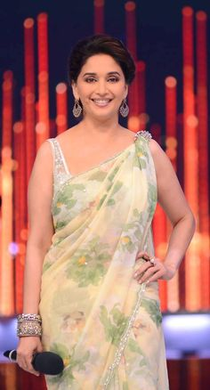 Top 10 Looks from Madhuri Dixit's Trousseau Bollywood Girls, Bollywood Saree, Bollywood Celebrities, Indian Attire, Indian Wear, Indian Dresses, Indian Outfits, Madhuri Dixit Hot, Floral Print Sarees