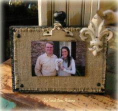 i love any of these kinds of wooden picture holders! I especially love it when they have burlap and a bow :)