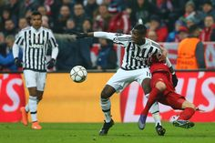 Paul Pogba of Juventus and Joshua Kimmich of Bayern Muenchen compete for the ball during the UEFA Champions League round of 16, second Leg match between FC Bayern Muenchen and Juventus at the Allianz Arena on March 16, 2016 in Munich, Germany. (March 15, 2016 - Source: Alexander Hassenstein/Bongarts)