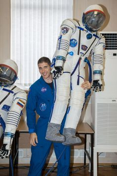 Astro Mike Hopkins holding his Soyuz spacesuit
