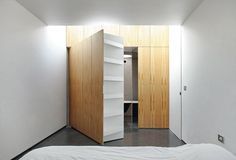 In the master bedroom, a rotating wall-cabinet gives access to a walk-in wardrobe and to the bathroom