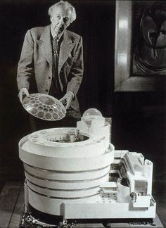 Frank Lloyd Wright in front of model of the Solomon R. Guggenheim Museum, New York, 1956