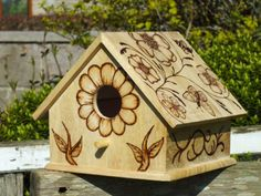 (Flowery Birdhouse Nest Box) like the designs. Wish I could draw.