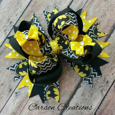 Large Batman hair bow, Black and yellow Batman bow, Superhero bow, Super hero hair bow, boutique bow, Comic hair bow, stacked hair bow by CarsonCreations07 on Etsy https://www.etsy.com/listing/223705817/large-batman-hair-bow-black-and-yellow