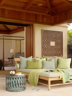 Although different from the usual beach themed room, which tends toward the blues and aquas with sand and coral colors, this Hawaiian lanai shows it's beach ones as paler wood tones, light sand, and sea greens. Love it!