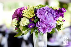 Vibrant purple centerpieces   Photo by http://nickanddeb.com Floral design by http://bridalbeginnings.ca