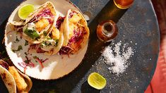 Fish tacos with flour tortillas (tacos de pescado) | Quick and easy to prepare, these tacos are a classic example of modern Mexican food. Originally, a tempura-style batter was introduced to Baja Peninsula by Japanese immigrants, but this soon morphed into a beer batter.