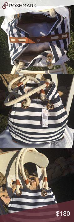 NWT Michael Kors Marina/ nautical bag Michael Kors Marina Navy blue/white striped canvas Grab bag, baby bag, school bag or everyday bag.  EXTRA LARGE Gold hardware Retail 278.00 Michael Kors Bags Baby Bags