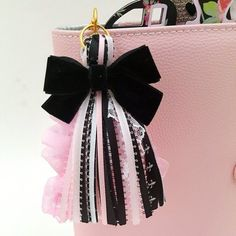 NEW!!! Pink, Black and White. Our tassels are multi-functional and can be added to any existing accessories. They are perfect for planners, handbags, back packs, strong enough to hold your keys, pouches, home decor and so much more. Tassels are our specialty, with 15+ years in jewelry designing, we put together a nice, cohesive, quality made piece. Handmade with lots of love using quality elements to create this beautifully for you. This tassel has a black velvet bow attached to it. This…