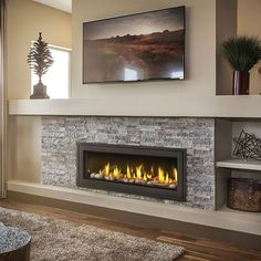"""The Vector by Napoleon is impressive, 50 inches impressive! Its amazing choice of contemporary fireplace medias, Napoleon's provides you with a luxurious fireplace experience. Enjoy the radiant glow from the standard Topaz CRYSTALINEâ""""¢ glass. Direct Vent Gas Fireplace, Vented Gas Fireplace, Tv Above Fireplace, Linear Fireplace, Basement Fireplace, Bedroom Fireplace, Home Fireplace, Fireplace Remodel, Fireplace Inserts"""