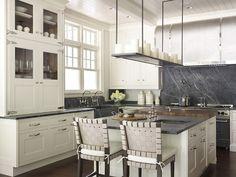 Ivory Kitchen Cabinets with Soapstone Countertop and Soapstone slab backsplash. Hickman Design Associates.