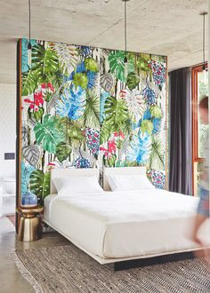 Tropical print statement wall in bedroom with white bed
