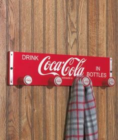 Retro Collectible Coke Coca Cola Wooden Crate Coat Rack w/Bottle Cap Hangers by Coca-Cola, http://www.amazon.com/dp/B004XD95VK/ref=cm_sw_r_pi_dp_UHryrb0SYQBZX