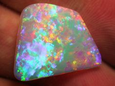 Cut and polished Brazilian crystal opal, 10.7 carats. Brightness of the fire in opal ranges on a scale of 1 to 5 (5 being the brightest).