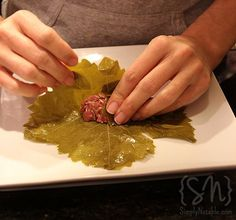 How to roll grape leaf- lebanese stuffed grape leaf. Haven't had any in awhile so I think I'll make some this weekend! YUM!!!! Along with some kibbeh and meat pies.