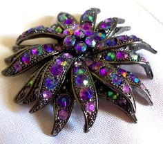 Very good vintage condition The brooch has multi layer construction. No missing stones-size 2 3/8 diameter....  #aurora borealis #flowers #japanned #purple #vintage #jewelry