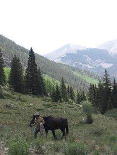 Leading horses from and to water during our stay in the Sangre de Cristos. #ZapataRanch