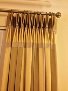 striped whiteheads fabric made in to double pleat curtains with fabric turned horizontal for a panel at the top