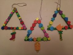 I made these with the kids today. Christmas Tree Ornaments. Made from popsicle sticks and foam craft stickers.