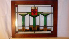 I have made this window several times and it continues to be popular. The red rose is in the craftsman style and really makes the piece pop. The
