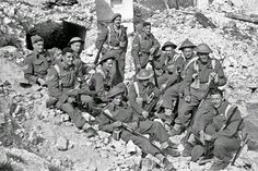 A group of New Zealand soldiers on the Cassino battlefront in Italy, during World War II. Probably reconstruction for photographers behind the line. 5 April 1944