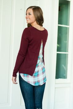 """Don't get mad, get plaid! This gorgeous wine sweater features some amazing plaid material peeking out in the back! Wanna show more? Just unzip! It's as simple as that!   Bra-friendly! Material has generous amount of stretch. Exposed zipper in the back.  Sara is wearing the size small.   Sizes fit:  Small- 0-4; Medium- 6, Large- 8-10  Length from shoulder to hem: S- 30""""; M- 31""""; L- 32""""."""
