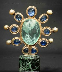 Intaglio of Julia, daughter of Titus. Aquamarine (2nd half of 1st CE) signed Evodos. Carolingian frame (9th) surrounded by 9 sapphires and 6 pearls. Cabinet des Medailles, Paris.