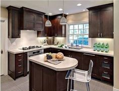 Lovd the dark cabinets and small island