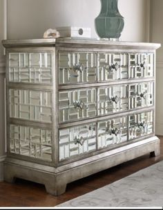 Mirrored dresser with rectangular mirror detailing gives it extra dimension. Perfect for the living room or entryway.