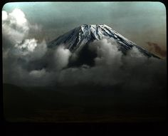 AT THE TOP OF OLD JAPAN - Dramatic View of Mt. Fuji's Summit.    A hand-tinted lantern slide by T. ENAMI ca.1895-1915. By Okinawa Soba (http://www.flickr.com/photos/24443965@N08/) More info here: http://www.flickr.com/photos/24443965@N08/2311125167/ and here: http://www.t-enami.org/